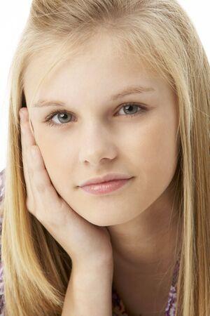 teen girl face: Studio Portrait Of Teenage Girl Stock Photo