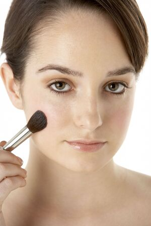 Teenage Girl Applying Make Up photo