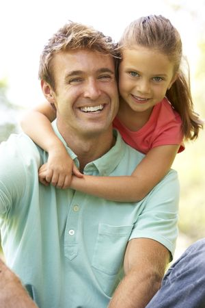 Portrait Of Father And Daughter In Park Stock Photo - 6143231