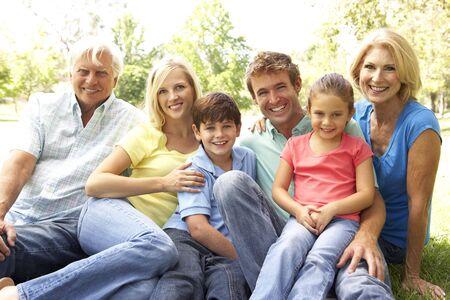 extended family: Extended Group Portrait Of Family Enjoying Day In Park