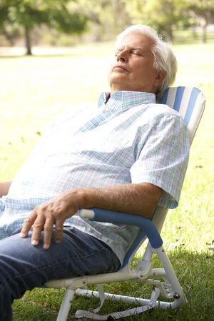 Senior Man Relaxing In Park photo