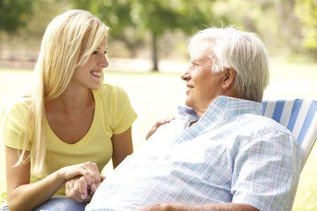 Senior Man Talking To Adult Daughter photo