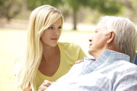 father daughter: Senior Man Talking To Concerned Adult Daughter Stock Photo