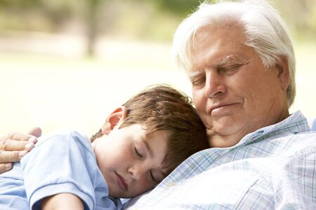 dozing: Grandfather And Grandson Taking Nap Together Stock Photo