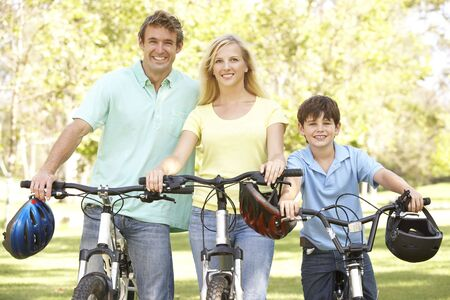 Parents And Son On Cycle Ride In Park photo