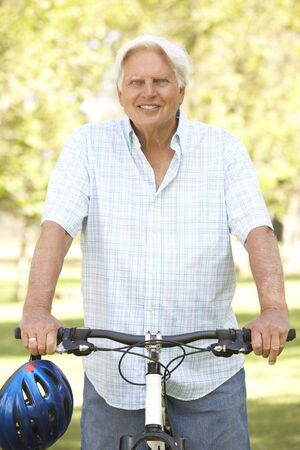Senior Man On Cycle Ride In Park Stock Photo - 6135754