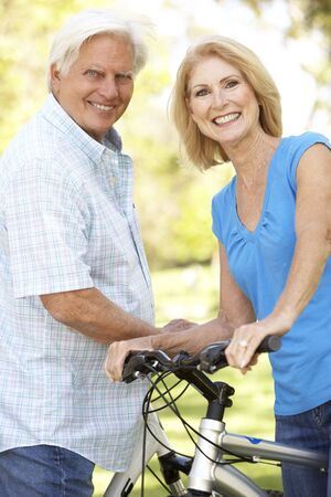 Senior Couple On Cycle Ride In Park photo