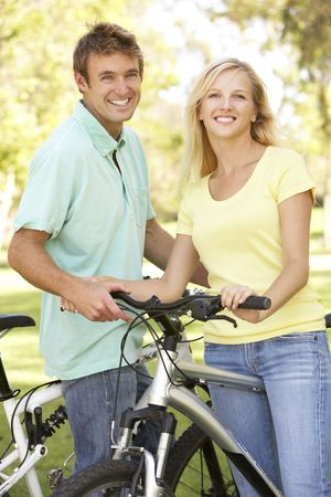 Young Couple On Cycle Ride in Park Stock Photo - 6128233