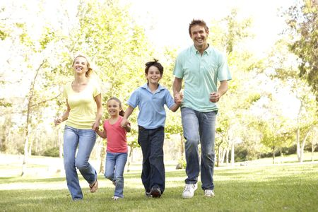 family garden: Family Running In Park