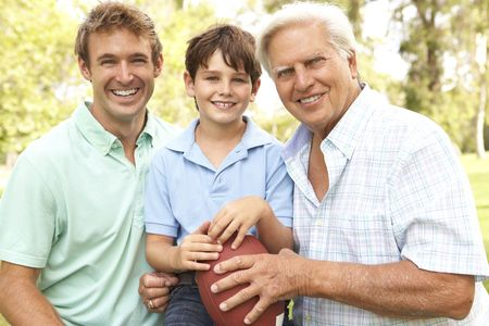 Grandfather With Father And Son Playing American Football Together photo