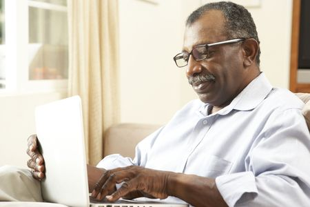 Senior Man Using Laptop At Home Stock Photo - 6135424