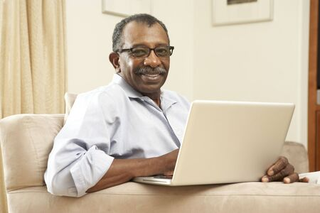 retired: Senior Man Using Laptop At Home