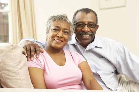 mature couple: Senior Couple Relaxing At Home Together
