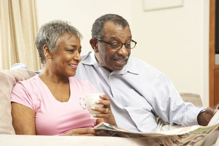and the horizontal man: Senior Couple Reading Newspaper At Home Stock Photo