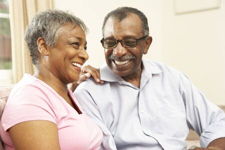 Senior Couple Relaxing At Home Together Stock Photo - 6135247