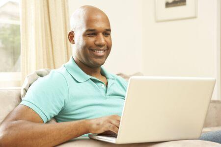 Man Using Laptop At Home photo