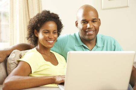 Couple Using Laptop At Home photo