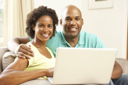 Couple Using Laptop At Home Stock Photo - 6128100