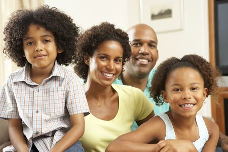 Family Relaxing At Home On Sofa Stock Photo - 6135249