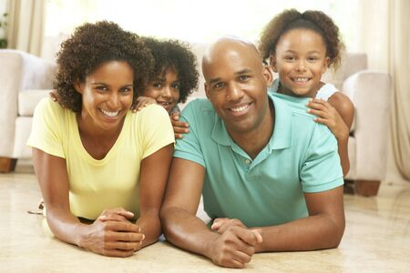 Family Relaxing At Home Together Stock Photo - 6135509