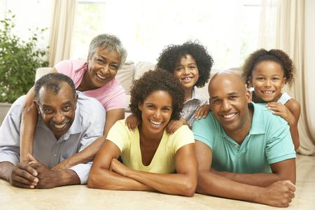 Extended Family Relaxing At Home Together photo