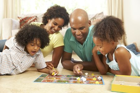 family asia: Family Playing Board Game At Home