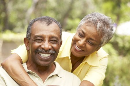 retired couple: Senior Couple Outdoors Hugging Stock Photo