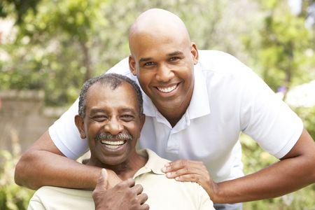 Senior Man Hugging Adult Son photo