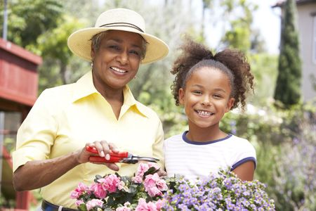 granddaughters: Grandmother With Granddaughter Gardening Together Stock Photo