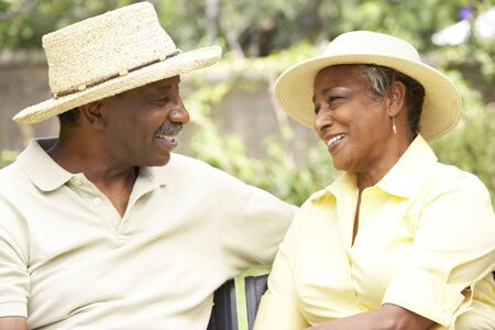 Senior Couple Relaxing In Garden Together Stock Photo - 6142699