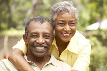 Senior Couple Relaxing In Garden Stock Photo - 6135712