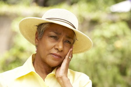 Senior Woman With Thoughtful Expression photo