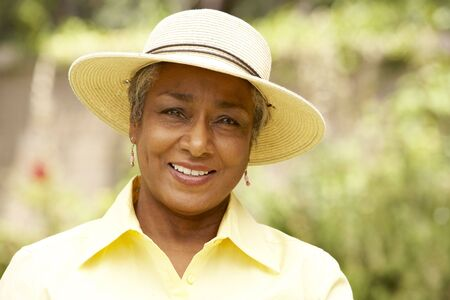 three women: Smiling Senior Woman In Garden Stock Photo