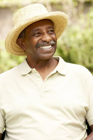 str: Smiling Senior Man In Garden Stock Photo