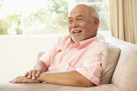 sit: Senior Man Relaxing In Chair At Home Stock Photo
