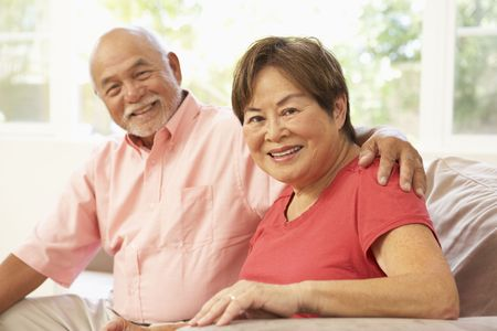 senior couples: Senior Couple Relaxing At Home Together