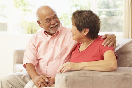 asian senior: Senior Couple Relaxing At Home Together