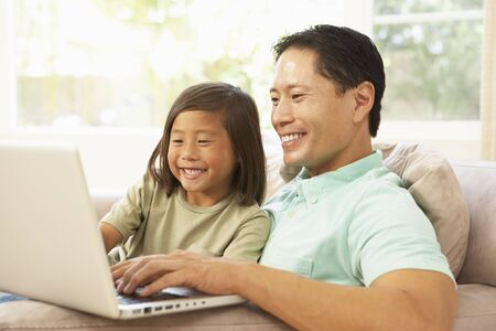 Father And Daughter Using Laptop At Home photo