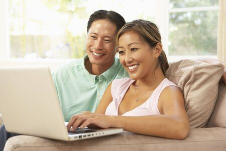 Young Couple Using Laptop At Home Stock Photo - 6128074