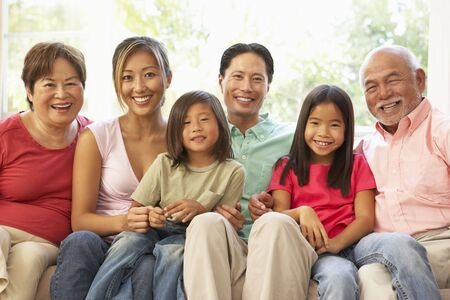 fourties: Extended Family Relaxing On Sofa At Home Together