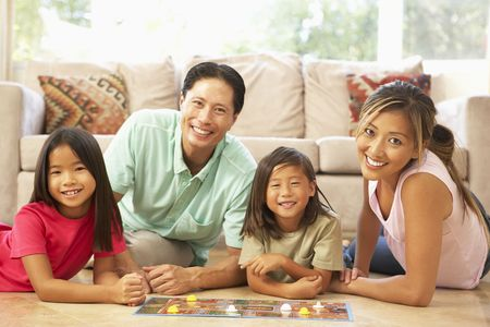 Family Playing Board Game At Home Stock Photo - 6135555