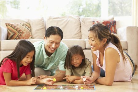 happy asian family: Family Playing Board Game At Home