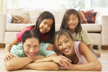 Young Family Relaxing At Home Stock Photo - 6128057