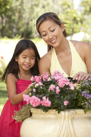 asian gardening: Mother And Daughter Gardening Together Stock Photo