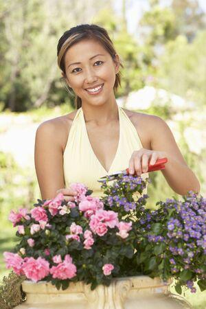 asian gardening: Young Woman Working In Garden