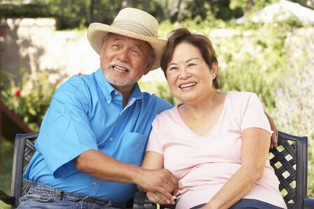 Senior Couple Relaxing In Garden Together Stock Photo - 6143031
