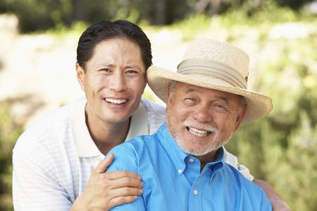 70s adult: Senior Man With Adult Son In Garden Stock Photo