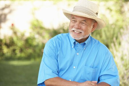 and the horizontal man: Senior Man Relaxing In Garden Stock Photo