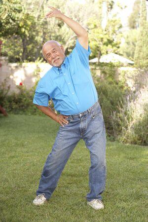 Senior Man Exercising In Garden Stock Photo - 6143397