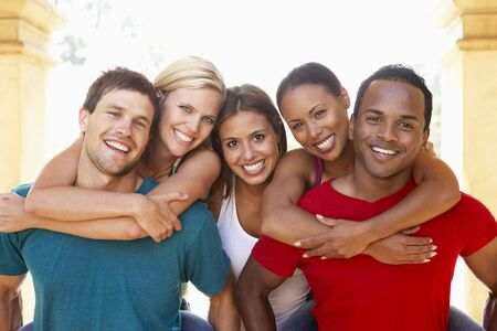 carrying girlfriend: Group Of Young Friends Having Fun Together